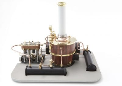 The Static steam unit features a Kingdon style vertical boiler coupled with a three-cylinder steam engine. The engine is equipped with an engine driven feed pump which allows for the replenishing of boiler water as it is consumed.